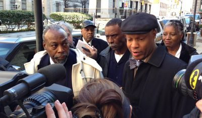 Julius Henson, left, and his lawyer, Russell A. Neverdon Sr., right, speak to the media outside of the Baltimore City Circuit Court Building Thursday, Feb. 27, 2014, in Baltimore. Judge Emanuel Brown ruled Thursday that Henson, convicted in a robocall conspiracy, must serve four months for violating his probation by filing to run for state Senate. Brown suspended his order for 30 days so Henson can appeal. (AP Photo/The Daily Record, Danny Jacobs)
