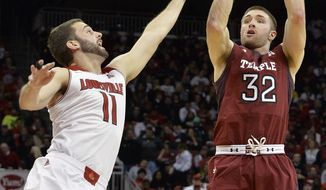 Temple's Dalton Pepper, right, puts up a shot over Louisville's Luke Hancock during the first half of an NCAA college basketball game, Thursday, Feb. 27, 2014, in Louisville, Ky. (AP Photo/Timothy D. Easley)