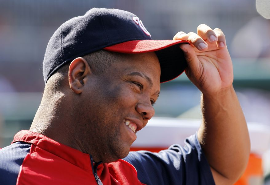 **FILE** Washington Nationals pitcher Livan Hernandez smiles at a teammate during the fifth inning of a baseball game against the Houston Astros in Washington, Sunday, Sept. 11, 2011. The Nationals beat the Astros 8-2. (AP Photo/Ann Heisenfelt)