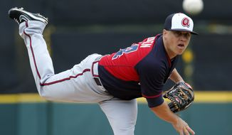 Atlanta Braves starting pitcher Kris Medlen (54) warms up before the first inning of an exhibition spring training baseball game against the Detroit Tigers in Lakeland, Fla., Thursday, Feb. 27, 2014. The Tigers won 5-2. (AP Photo/Gene J. Puskar)