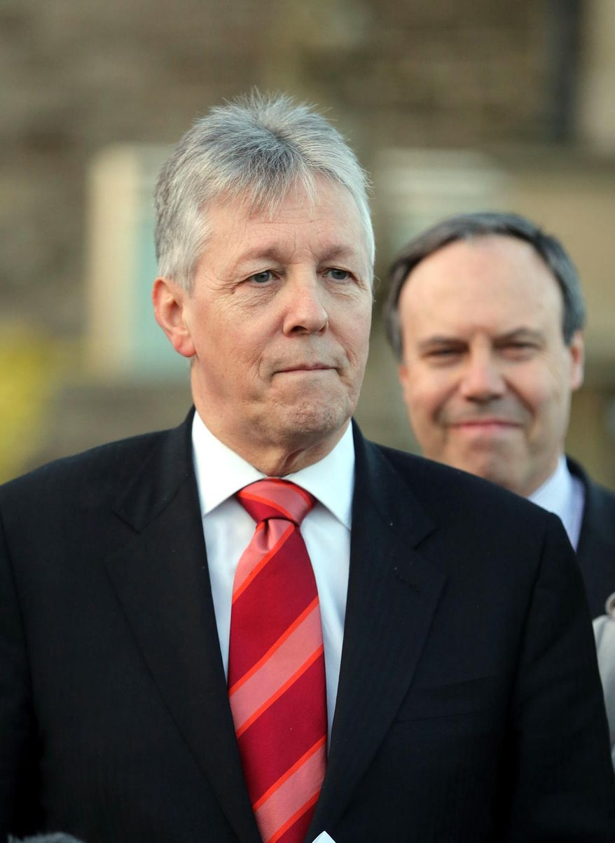 Northern Ireland First Minister Peter Robinson pauses as he speaks to the media at Stormont, Belfast, Northern Ireland, Thursday, Feb. 27, 2014.  Robinson has welcomed the inquiry set up to look into the NI secret letters row and also said he was happy with the terms of reference for the inquiry.  He had threatened to resign over the issue of 'On the Runs' - republican paramilitary suspects who were given assurances that they were not being sought by police.  (AP Photo)