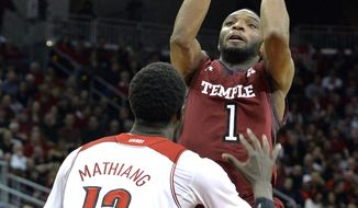 Temple's Josh Brown shoots over Louisville's Mangok Mathiang during the first half of an NCAA college basketball game, Thursday, Feb. 27, 2014, in Louisville, Ky. (AP Photo/Timothy D. Easley)