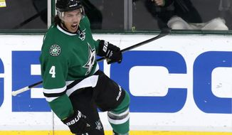 Dallas Stars defenseman Brenden Dillon (4) celebrates his short-handed goal against the Carolina Hurricanes during the first period of an NHL hockey game on Thursday, Feb. 27, 2014, in Dallas. (AP Photo/Sharon Ellman)