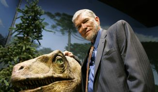 Ken Ham, founder of the nonprofit ministry Answers in Genesis, poses with one of his favorite animatronic dinosaurs during a tour of the Creation Museum in Petersburg, Ky., in this May 24, 2007, file photo. (AP Photo/Ed Reinke, File)