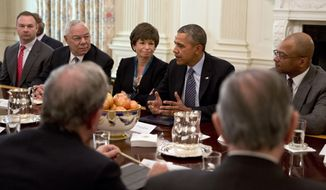 """President Barack Obama, next to White House Senior Adviser Valerie Jarrett, left, and former Secretary of State Colin Powell, meets with foundation and business leaders in the State Dining Room of the White House in Washington, Thursday, Feb. 27, 2014, where he discussed his """"My Brother's Keeper"""" initiative to expand opportunity for minority boys and young men. Former Lakers basketball star Magic Johnson, far left partially obscured, also attended. (AP Photo/Jacquelyn Martin)"""