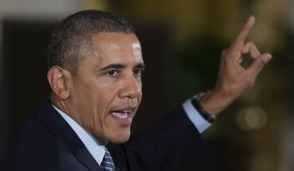 """** FILE ** President Barack Obama gestures while speaking in the East Room of the White House in Washington, Thursday, Feb. 27, 2014, to promote his """"My Brother's Keeper"""" initiative. (AP Photo/ Evan Vucci)"""