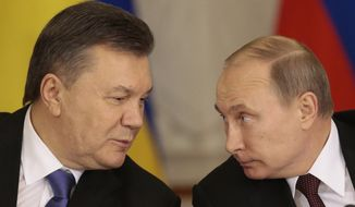 """** FILE ** In this Tuesday Dec. 17, 2013, file photo, Russian President Vladimir Putin, right, and his Ukrainian counterpart Viktor Yanukovych talk during a news conference in Moscow. Moscow on Wednesday granted Ukrainian President Viktor Yanukovych protection """"on the territory of Russia,"""" shortly after the fugitive leader sought help from the Kremlin, according to an official quoted by Russian news agencies. (AP Photo/Ivan Sekretarev, file)"""