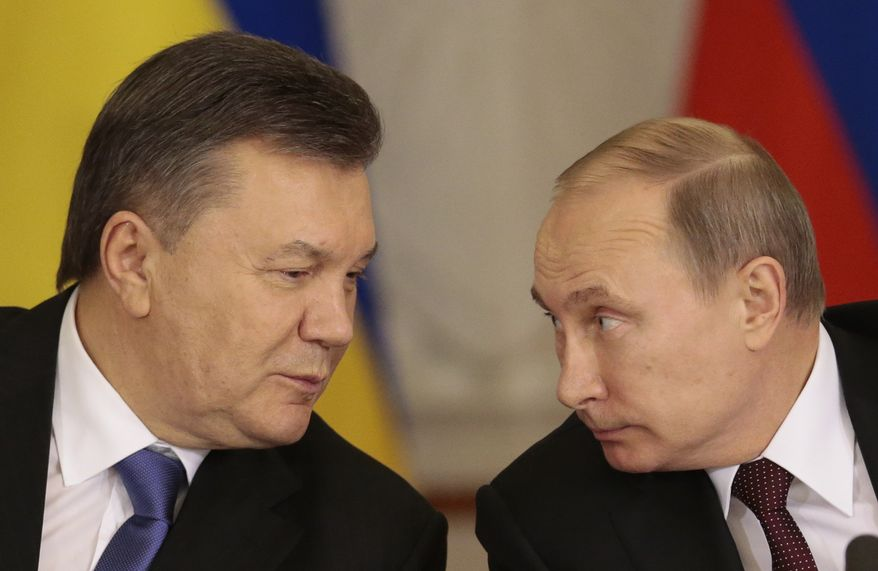 "** FILE ** In this Tuesday Dec. 17, 2013, file photo, Russian President Vladimir Putin, right, and his Ukrainian counterpart Viktor Yanukovych talk during a news conference in Moscow. Moscow on Wednesday granted Ukrainian President Viktor Yanukovych protection ""on the territory of Russia,"" shortly after the fugitive leader sought help from the Kremlin, according to an official quoted by Russian news agencies. (AP Photo/Ivan Sekretarev, file)"