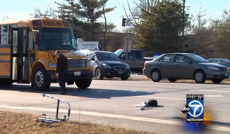 Elia Miranski's walker is seen at the Columbia Pike/Tech Road intersection in Silver Spring, Md. Miranski, a 91-year-old Holocaust survivor, died Wednesday afternoon after being hit by a school bus. (WJLA)