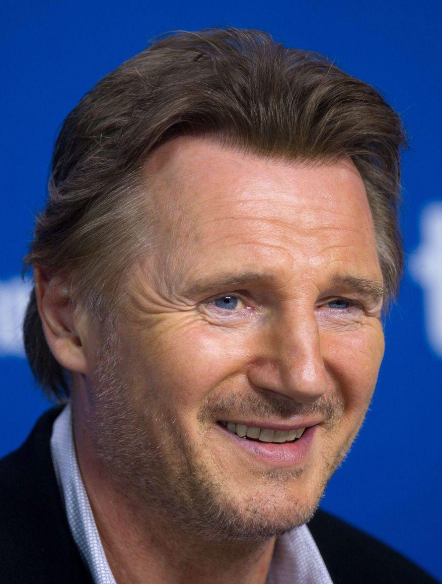 "File-This Sept. 10, 2013 file photo shows actor Liam Neeson smiling during a press conference for ""Third Person"" at the 2013 Toronto International Film Festival in Toronto. Neeson says he's ""a little bit pissed off"" at Mayor Bill de Blasio for wanting to shut down the horse-drawn carriage industry in New York City. Neeson made the comment during an appearance on ""The Daily Show"" Wednesday, Feb. 26, 2014. The actor complained to host John Stewart that critics have put out false information about how the horses are treated. He says the carriage drivers treat the horses like their own children.  (AP Photo/The Canadian Press, Galit Rodan, File)"