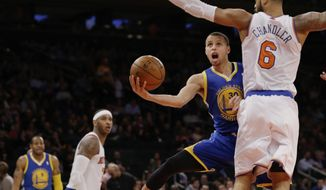 Golden State Warriors' Stephen Curry (30) drives past New York Knicks' Tyson Chandler (6) during the second half of an NBA basketball game on Friday, Feb. 28, 2014, in New York. (AP Photo/Frank Franklin II)