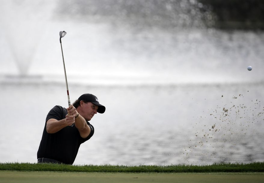 Phil Mickelson hits out of a bunker onto the 18th green during the second round of the Honda Classic golf tournament, Friday, Feb. 28, 2014, in Palm Beach Gardens, Fla. (AP Photo/Lynne Sladky)