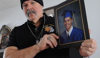 ADVANCE FOR MONDAY, MARCH 3 AND THEREAFTER - In a Feb. 11, 2014 photo, retired detective Donald Vandercook of Monroe, Mich., holds up a photo of his son, Matthew Vandercook, Matthew, was 21, athletic and seemingly healthy, when he died unexpectedly in October while away at school. Matthew died in his sleep of Long QT Syndrome, a rare genetic heart disorder that causes quickened and chaotic heartbeats. (AP Photo/The Monroe Evening News, Tom Hawley)