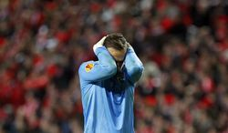 PAOK's goalkeeper Panagiotis Glykos reacts during the Europa League round of 32 second leg soccer match between Benfica and PAOK at Benfica's Luz stadium in Lisbon, Thursday, Feb. 27, 2014. Benfica won 3-0. (AP Photo/Francisco Seco)