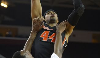 Oregon State forward Devon Collier, top, goes up for a shot as USC guard Byron Wesley defends during the first half of an NCAA college basketball game, Thursday, Feb. 27, 2014, in Los Angeles. (AP Photo/Mark J. Terrill)