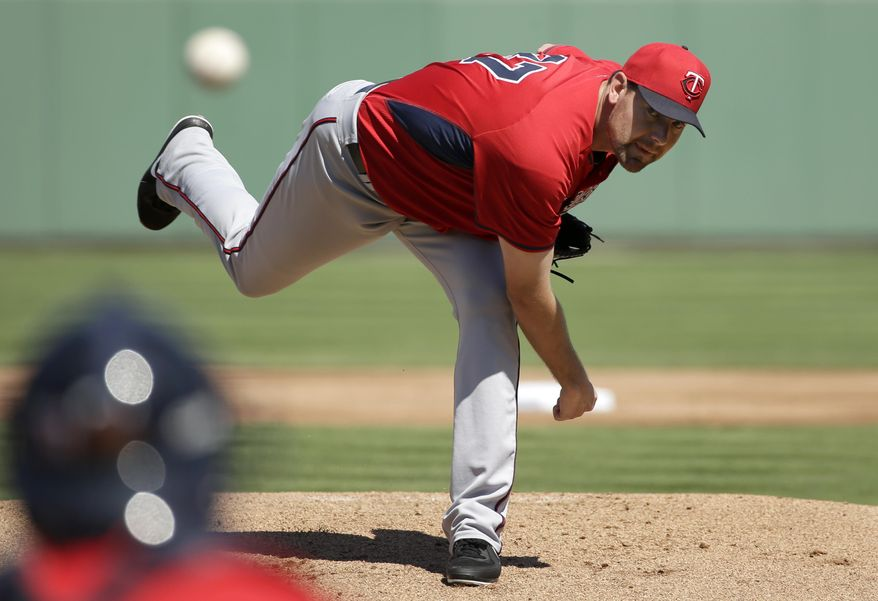 Minnesota Twins pitcher Mike Pelfrey, follows through on a warm-up throw in the first inning of an exhibition baseball game against the Boston Red Sox, Friday, Feb. 28, 2014, in Fort Myers, Fla. (AP Photo/Steven Senne)