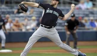 Seattle Mariners' James Paxton delivers to the San Diego Padres in the first inning of an exhibition baseball game on Friday Feb. 28, 2014, in Peoria, Ariz. (AP Photo/Tony Gutierrez)