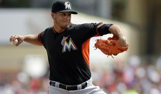 Miami Marlins starting pitcher Jose Fernandez throws during the first inning of an exhibition spring training baseball game against the St. Louis Cardinals Friday, Feb. 28, 2014, in Jupiter, Fla. (AP Photo/Jeff Roberson)