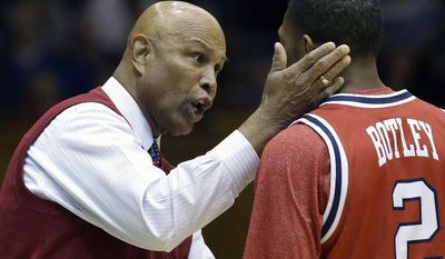 Florida Atlantic coach Mike Jarvis speaks with Marquan Botley (2) during the first half of an NCAA college basketball game against Duke in Durham, N.C., Friday, Nov. 15, 2013. (AP Photo/Gerry Broome)