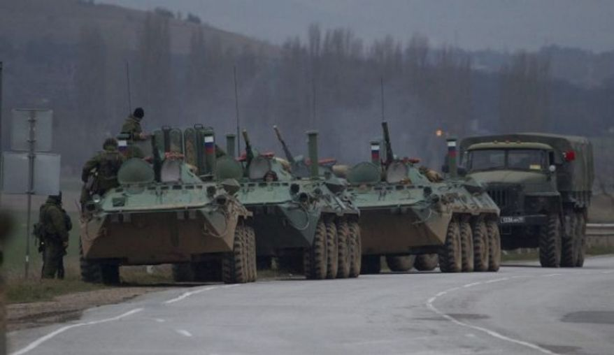 Russian armored personnel carriers and a truck are parked on the side of the road near the town of Bakhchisarai, Ukraine, Feb. 28, 2014. (Associated Press)