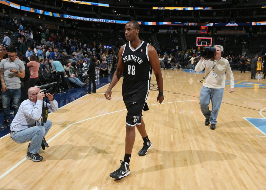 Brooklyn Nets center Jason Collins heads off the court after the Nets' 112-89 victory over the Denver Nuggets in an NBA basketball game in Denver on Thursday, Feb. 27, 2014. (AP Photo/David Zalubowski)