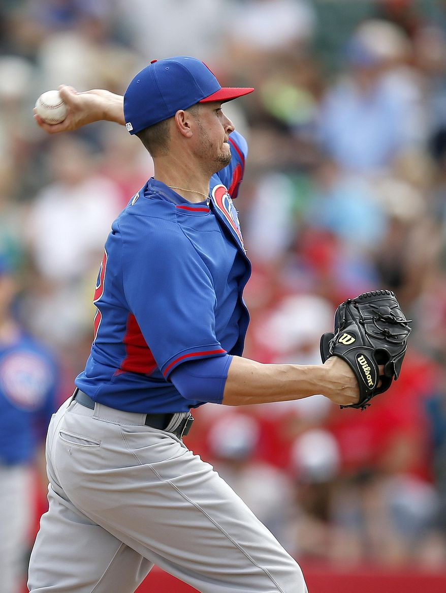 Chicago Cubs' Chris Rusin delivers a pitch in the second inning during a spring training baseball game against the Los Angeles Angels on Friday, Feb. 28, 2014, in Tempe, Ariz. (AP Photo/Ross D. Franklin)