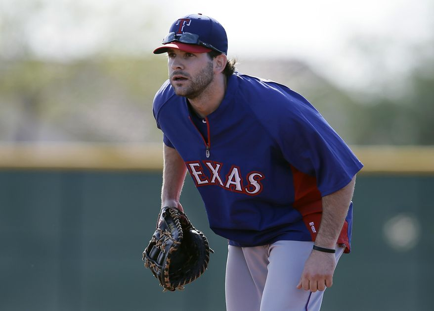 FILe - In this Feb. 18, 2014 file photo, Texas Rangers infielder Mitch Moreland (18) practices at spring training in Surprise, Ariz.  Moreland's role with the Rangers immediately changed when they acquired slugger Prince Fielder. There was even some uncertainty if Moreland would still be with Texas. Moreland is still with Texas, and is spending most of his time so far in spring training with the outfielders.(AP Photo/Tony Gutierrez, File)