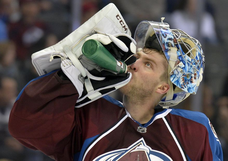 Colorado Avalanche goalie Semyon Varlamov cools off during the second period of an NHL hockey game against the Phoenix Coyotes, Friday, Feb. 28, 2014, in Denver. (AP Photo/Jack Dempsey)