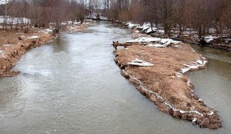 In this photo taken on Feb. 25, 2015, Wildcat Creek flows south of Deer Creek in Logansport, Ind. A report pending state and federal approval aims to clean up the waterways in the Deer Creek-Sugar Creek watershed, which flows through southern Cass County and is bordered on the south by the Wildcat Creek watershed. (AP Photo/The Pharos-Tribune, Steve Summers)