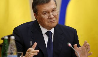 Ukraine's fugitive President Viktor Yanukovych speaks at a news conference in Rostov-on-Don, a city in southern Russia about 1,000 kilometers (600 miles) from Moscow, Friday, Feb. 28, 2014. Yanukovych, making his first public appearance since fleeing Ukraine, said he was forced to leave the country after his family received threats. (AP Photo/Pavel Golovkin)