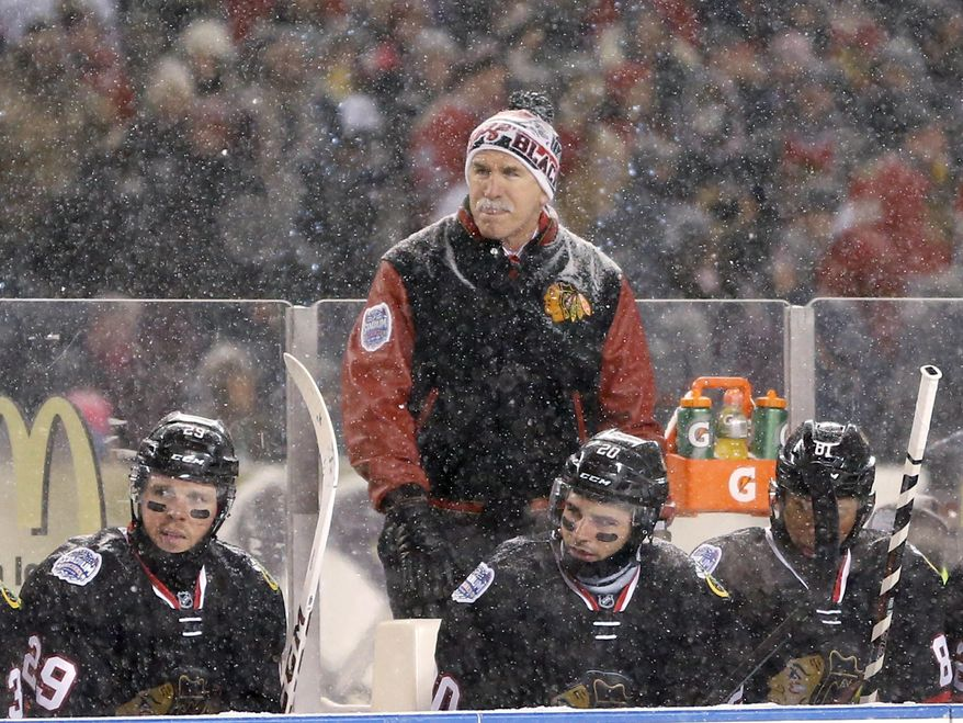 Chicago Blackhawks coach Joel Quenneville watches his team skate again the Pittsburgh Penguins during the first period of an NHL Stadium Series hockey game at Soldier Field on Saturday, March 1, 2014, in Chicago. (AP Photo/Charles Rex Arbogast)