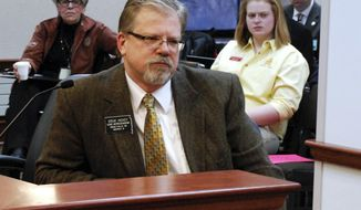 FILE - In this Jan. 30, 2014 file photo, Rep. Steve Hickey, R-Sioux Falls, is seen at a legislative committee hearing in Pierre, S.D. The presence of the National Rifle Association in the South Dakota Capitol has caused a stir among representatives in the House. Hickey says even though he supports gun rights, not all gun legislation is good legislation. (AP Photo/Chet Brokaw, File)