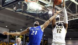 Virginia Commonwealth's Mo Alie-Cox, right, hauls in a rebound over Saint Louis's Dwayne Evans during the second half of an NCAA college basketball game, Saturday, March 1, 2014 in Richmond, Va. (AP Photo/Jason Hirschfeld)
