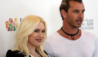 "FILE - In this June 2, 2013 file photo, Gwen Stefani and Gavin Rossdale arrive at Elizabeth Glaser Pediatric AIDS Foundation's 24th Annual ""A Time for Heroes"" event in Los Angeles. A rep confirmed that Stefani and Rossdale welcomed their third son, Apollo Bowie Flynn Rossdale, on Friday, Feb. 28, 2014. (Photo by Jose Flores/Invision/AP, File)"