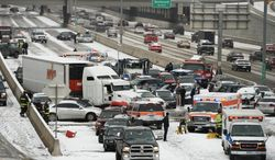 Emergency workers respond to a massive pileup accident on Interstate 25 in Denver, Saturday, March 1, 2014. Authorities say one person was killed and 30 others were injured in the giant pileup. (AP Photo/The Denver Post, Hyoung Chang) MAGS OUT; TV OUT; INTERNET OUT; NO SALES; NEW YORK POST OUT; NEW YORK DAILY NEWS OUT