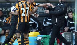 Newcastle United's manager Alan Pardew,  right,  and Hull City's David Meyler, 3rd left, confront each other during the during the English Premier League match at the KC Stadium, Hull England Saturday March 1, 2014. (AP Photo/Lynne Cameron/PA)  UNITED KINGDOM OUT