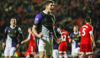 Liverpool's Steven Gerrard, centre, reacts after scoring a goal from a penalty shot,  during their English Premier League match against Southampton, at St Mary's, Southampton, England, Saturday March 1, 2014. (AP Photo/PA, Chris Ison) UNITED KINGDOM OUT