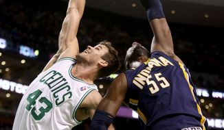 Boston Celtics center Kris Humphries (43) and Indiana Pacers center Roy Hibbert (55) vie for a rebound during the first half of an NBA basketball game on Saturday, March 1, 2014, in Boston. (AP Photo/Mary Schwalm)