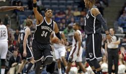 Brooklyn Nets' Marcus Thornton, right, and teammate Paul Pierce (34) celebrate Thornton's 3-point basket against the Milwaukee Bucks in the second half of an NBA basketball game Saturday, March 1, 2014, in Milwaukee. (AP Photo/Jeffrey Phelps)