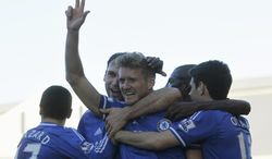 Chelsea's Andre Schurrle, center, celebrates his third goal against Fulham with teammates during their English Premier League soccer match at Craven Cottage, London, Saturday, March 1, 2014. (AP Photo/Sang Tan)