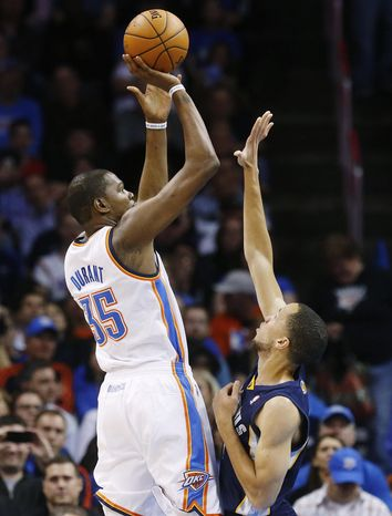 Oklahoma City Thunder forward Kevin Durant (35) shoots over Memphis Grizzlies forward Tayshaun Prince (21) during the first quarter of an NBA basketball game in Oklahoma City, Friday, Feb. 28, 2014. The Thunder won 113-107. (AP Photo/Sue Ogrocki)