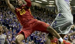 Iowa State's DeAndre Kane (50) gets past Kansas State's D.J. Johnson, right, to put up a shot during the first half of an NCAA college basketball game Saturday, March 1, 2014, in Manhattan, Kan. (AP Photo/Charlie Riedel)