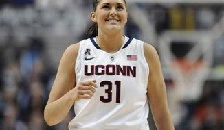 Connecticut's Stefanie Dolson smiles during the first half of an NCAA college basketball game against Rutgers, Saturday, March 1, 2014, in Storrs, Conn. (AP Photo/Jessica Hill)