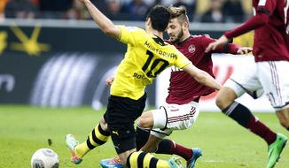 Dortmund's Henrikh Mkhitaryan of Armenia, center, scores during the German first division Bundesliga soccer match between BvB Borussia Dortmund and 1.FC Nuremberg in Dortmund, Germany, Saturday, March 1, 2014. (AP Photo/Frank Augstein)