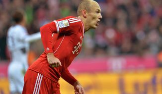 Bayern's  Arjen Robben of the Netherlands celebrates after scoring, during the German first division Bundesliga soccer match between  FC Bayern Munich and FC Schalke in Munich, Germany, on Saturday, March 1. 2014. (AP Photo/Kerstin Joensson)