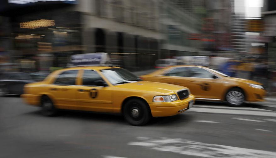 New York City taxis pass through New York's Times Square, Thursday, Feb. 27, 2014. Under ambitious proposals that seek to get New York City cabs to slow down by taking the financial incentive out of speeding, black boxes inside cabs would shut the toll meter off whenever a cab goes above the posted limit - 25 mph in much of Manhattan - and drivers would be alerted they are going too fast. (AP Photo/Richard Drew)