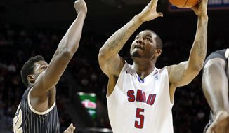 SMU forward Markus Kennedy (5) looks to shoot as Central Florida forward Staphon Blair (52) defends during the second half of an NCAA college basketball game on Saturday, March 1, 2014, in Dallas. SMU won the game 70-55. (AP Photo/John F. Rhodes)