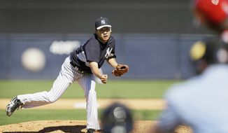 New York Yankees pitcher Masahiro Tanaka throws a pitch during the sixth inning of an exhibition baseball game against the Philadelphia Phillies Saturday, March 1, 2014, in Tampa, Fla. (AP Photo/Charlie Neibergall)