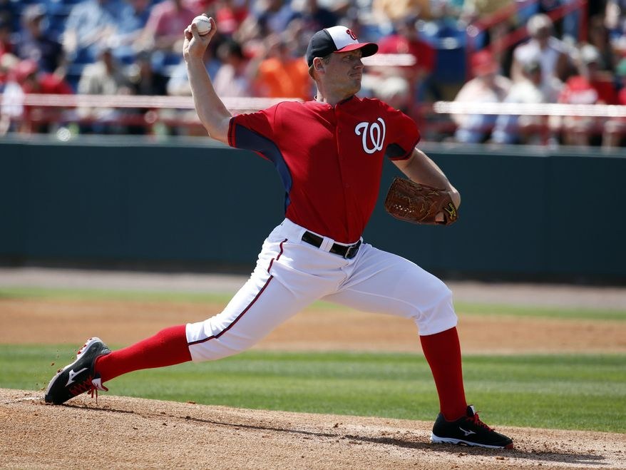 Washington Nationals starting pitcher Jordan Zimmermann throws in the first inning of a spring exhibition baseball game against the Atlanta Braves, Saturday, March 1, 2014, in Viera, Fla. (AP Photo/Alex Brandon)