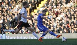 Chelsea's Andre Schurrle, right, kicks the ball to score his second goal against Fulham during their English Premier League soccer match at Craven Cottage, London, Saturday, March 1, 2014. (AP Photo/Sang Tan)